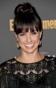 Constance Zimmer attended the Entertainment Weekly pre-Emmy party sporting a towering top-knot with wispy bangs.