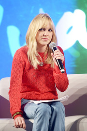 Anna Faris was casual and cute in a red knit sweater while attending Entertainment Weekly's PopFest.