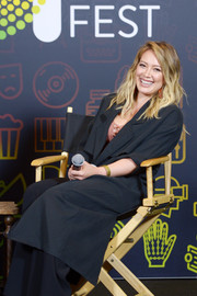 Hilary Duff bundled up in a black duster while attending Entertainment Weekly's PopFest.