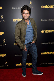 Adrian Grenier kept it casual in an olive-green moto jacket and blue jeans at the New York premiere of 'Entourage.'