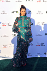 Nikki Reed went the boho route in a floral maxi dress by Tadashi Shoji for her EMA Awards look.
