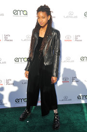 Willow Smith toughened up her jumpsuit with a black leather jacket.