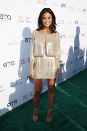 Emmanuelle Chriqui looked party-ready in a gold sequin mini dress with a loose bodice overlay at the 2017 EMA Awards.