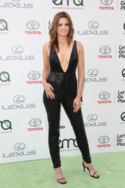 Stana Katic ravished in a body-skimming, deep-V black sequin jumpsuit by Naeem Khan at the EMA Awards.