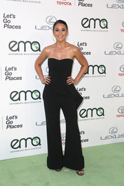 Emmanuelle Chriqui hit the EMA Awards rocking a flared, strapless jumpsuit by Stella McCartney.
