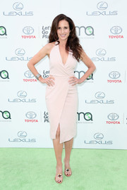 Andie MacDowell kept it classic and sexy in a plunging nude wrap dress at the EMA Awards.