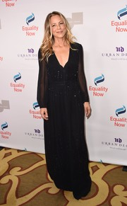 Maria Bello kept it classic in a long-sleeve, subtly embellished black gown at the Make Equality Reality Gala.