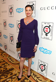 Janice Dickinson showed her more elegant side in a purple cocktail dress with blouson sleeves during the Make Equality Reality event.