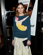 Olivia Palermo arrived for the New York screening of 'Equalizer 2' carrying a black sequined clutch.