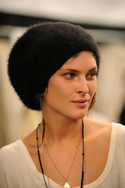 Erin pulled her long locks into a bun and tucked into under he knit beanie.