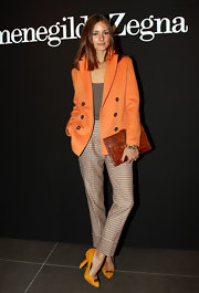 Olivia looked ultra-stylish in an orange blazer and plaid slacks for Fashion Week in Milan.
