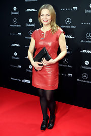 Anna Loos wore this red leather dress with a black clutch and opaque tights for the Berlin Escada fashion show.