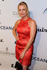 Nicolette Sheridan wore her hair in a tight bun, with several loose and delicate tresses.