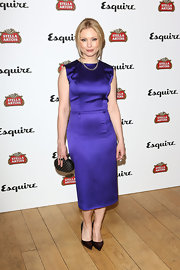 Myanna Buring chose a royal purple sleeveless sheath dress for her look at the Esquire Summer Party.