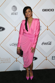 Susan Kelechi Watson matched her dress with a pair of pink satin pumps.