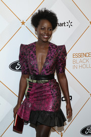 Lupita Nyong'o paired a purple Christian Louboutin velvet clutch with a floral mini dress for the Essence Black Women in Hollywood Awards.