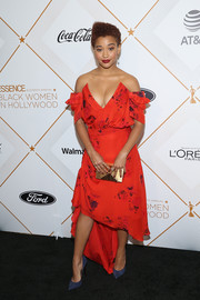 Amandla Stenberg looked beguiling in a deep-V red off-the-shoulder dress by Preen at the Essence Black Women in Hollywood Awards.