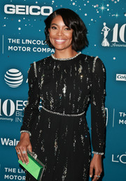 Gabrielle Union accessorized with a green box clutch for a pop of color to her dress at the Essence Black Women in Hollywood Awards.