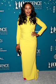 June Ambrose radiated in a yellow Michael Costello column dress with an embroidered midsection at the Essence Black Women in Hollywood Awards.