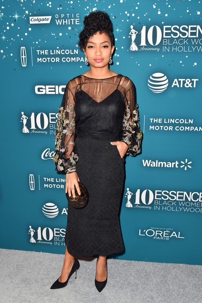 Yara Shahidi completed her ensemble with a tortoiseshell clutch by Chanel.