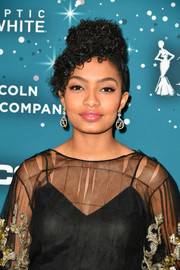 Yara Shahidi styled her hair into a curly updo for the Essence Black Women in Hollywood Awards.