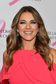 Elizabeth Hurley sported her signature center-parted waves at the Estee Lauder 2018 Breast Cancer Campaign event.