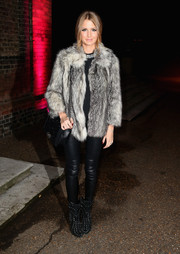 For an even edgier finish, Millie Mackintosh teamed her leather pants with a pair of studded black boots.