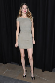 Alice Taglioni wore a fitted suede sheath dress for the Etam fashion show.