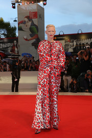 Tilda Swinton looked striking in a red and white animal-print gown by Schiaparelli Couture at the Venice Film Festival screening of 'At Eternity's Gate.'