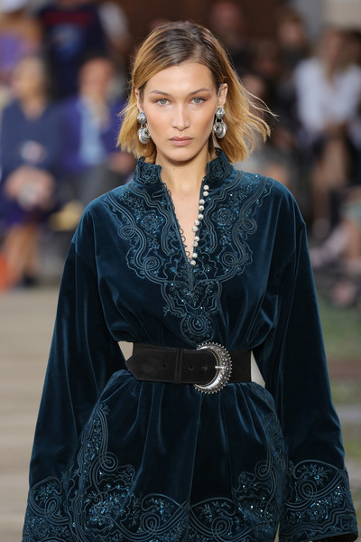 Bella Hadid looked opulent wearing this oversized suede belt and velvet dress combo at the Etro Spring 2020 show.