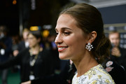 Alicia Vikander swept her hair back into a loose chignon for the Zurich Film Festival premiere of 'Euphoria.'