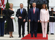 Melania Trump opted for a pale pink pantsuit by Calvin Klein when she attended the arrival ceremony for the President of Poland.