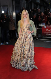 Elle Fanning already looked like superwoman in that enchanting floral gown—but she threw on a print mint cape, just in case.