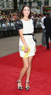 Amber Le Bon carried an eye-catching yellow tasseled purse at the 'Public Enemies' premiere.