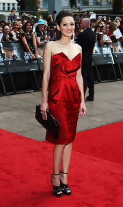 The French actress wore a knock-out red Vivienne Westwood dress accompained by a pair of killer Dior shoes for an overall stunning look.