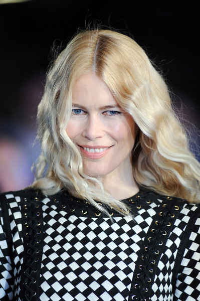 Claudia Schiffer looked like a doll with her long blonde waves at the European premiere of 'Eddie the Eagle.'