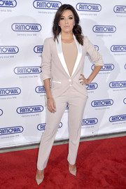 Eva Longoria manned up in a smart blush suit for the opening of the Rimowa store in Miami.