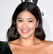 Gina Rodriguez looked pretty with her wavy hairstyle at the Eva Longoria Foundation dinner.