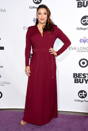 Eva Longoria kept it simple yet stylish in a wine-red wrap gown by Elisabetta Franchi at the Eva Longoria Foundation dinner.