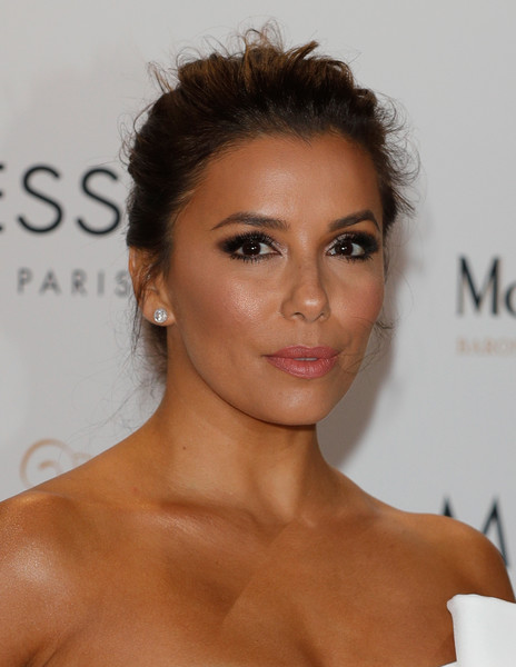 Eva Longoria Messy Updo [hair,face,eyebrow,hairstyle,skin,chin,lip,beauty,forehead,shoulder,cannes,france,eva longoria global gift gala,cannes film festival,eva longoria]
