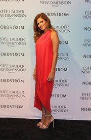 Eva Mendes went for classic sophistication in a floaty red one-shoulder dress by Halston Heritage during the Estee Lauder New Dimension Skincare launch.
