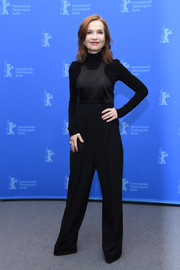 Isabelle Huppert teamed her jumpsuit with a black turtleneck sweater.
