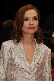 Isabelle Huppert wore sweet shoulder-length curls at the Berlinale premiere of 'Eva.'