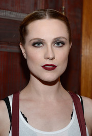 For her beauty look, Evan Rachel Wood paired a matte red lip with a smoky eye.