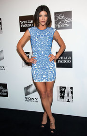 Jessica Szohr showed off her toned limbs with this printed blue-and-white cap-sleeve dress.