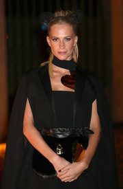 A fur and leather clutch added lots of flair to Poppy Delevingne's look during the Global Fund event.