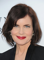 A bold cherry red lip color added instant glam to Elizabeth's look.