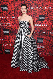 Emmy Rossum was a vision in a strapless gingham-print ball gown at the Evening Honoring Carolina Herrera event.