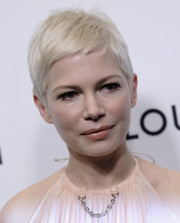 Michelle Williams stuck to her signature platinum-blonde pixie when she attended the Evening Honoring Louis Vuitton event.