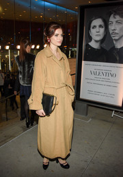 Tali Lennox bundled up in an oversized tan coat for the Evening Honoring Valentino event.